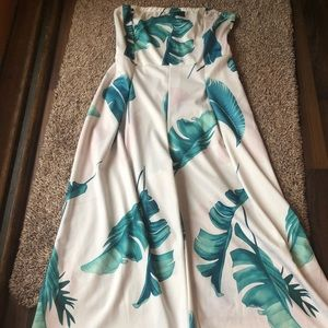 Tropical jumpsuit size small to medium.